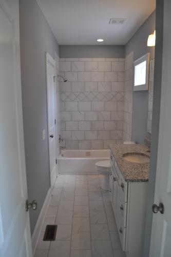 Large Hall Bath With Custom Tile